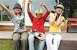 2 teenage girls and boy shouting, sitting on a terrace Stock Photo - Premium Royalty-Free, Artist: Aurora Photos, Code: 6108-05857771