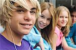 2 teenage boys and 2 teenage girls smiling for camera