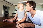 Father and son in kitchen, indoors Stock Photo - Premium Royalty-Free, Artist: Blend Images, Code: 6108-05857953