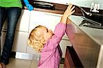 Little girl in kitchen trying to catch a frying pan on stove, indoors Stock Photo - Premium Royalty-Free, Artist: AlaskaStock, Code: 6108-05857954