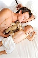 Father and baby sleeping, view from above, indoors Stock Photo - Premium Royalty-Freenull, Code: 6108-05857982