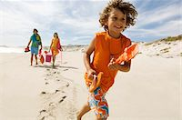 Parents and little boy walking on the beach, outdoors Stock Photo - Premium Royalty-Freenull, Code: 6108-05858069