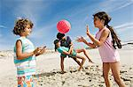 Parents and two children playing on the beach, outdoors Stock Photo - Premium Royalty-Free, Artist: theblackrhino                 , Code: 6108-05858077