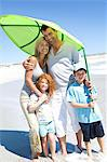 Parents and two children on the beach, posing for the camera, outdoors Stock Photo - Premium Royalty-Free, Artist: Masterfile, Code: 6108-05858084