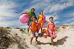 Parents and two children walking on the beach, outdoors Stock Photo - Premium Royalty-Free, Artist: theblackrhino                 , Code: 6108-05858086