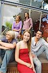 Parents and three teenagers in front of their house, indoors Stock Photo - Premium Royalty-Freenull, Code: 6108-05858289