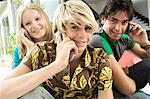 3 teenagers using mobile phones Stock Photo - Premium Royalty-Free, Artist: CulturaRM, Code: 6108-05858632
