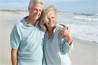 Smiling couple embracing on the beach Stock Photo - Premium Royalty-Freenull, Code: 6108-05858733