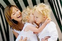 people kissing little boys - Mother and 2 children on a swing chair Stock Photo - Premium Royalty-Freenull, Code: 6108-05859181