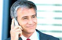 Mature businessman using mobile phone, close-up Stock Photo - Premium Royalty-Freenull, Code: 6108-05859246