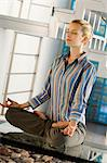 Young woman practicing yoga Stock Photo - Premium Royalty-Free, Artist: Cultura RM, Code: 6108-05859288