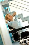 Young businesswoman relaxing on office chair Stock Photo - Premium Royalty-Free, Artist: Robert Harding Images, Code: 6108-05859294
