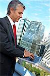 Mature businessman using laptop in balcony Stock Photo - Premium Royalty-Free, Artist: Jean-Yves Bruel, Code: 6108-05859354