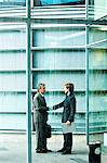 Businessmen shaking hands by office building Stock Photo - Premium Royalty-Free, Artist: Cultura RM, Code: 6108-05859396