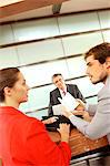Businessmen and businesswoman conversing in office Stock Photo - Premium Royalty-Free, Artist: Westend61, Code: 6108-05859462