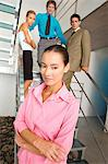 Businesswoman standing with colleagues in background Stock Photo - Premium Royalty-Free, Artist: CulturaRM, Code: 6108-05859591