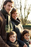 Portrait of two children smiling with their parents Stock Photo - Premium Royalty-Freenull, Code: 6108-05859795