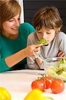 smelly - Young woman feeding basil to her son Stock Photo - Premium Royalty-Freenull, Code: 6108-05859892