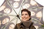 Close-up of a mid adult woman holding an umbrella Stock Photo - Premium Royalty-Free, Artist: Aflo Relax, Code: 6108-05859970
