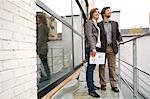 Mid adult man and a young woman standing at a balcony Stock Photo - Premium Royalty-Free, Artist: CulturaRM, Code: 6108-05860122