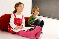 pantyhose kid - Boy and a girl drawing on notepads Stock Photo - Premium Royalty-Freenull, Code: 6108-05860272