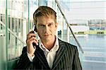 Portrait of a businessman talking on a mobile phone at an airport Stock Photo - Premium Royalty-Free, Artist: Cultura RM, Code: 6108-05860476