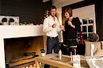 Mid adult man and a young woman lighting a candle with a cigarette lighter Stock Photo - Premium Royalty-Free, Artist: Jose Luis Stephens, Code: 6108-05860662