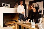 Mid adult man and a young woman celebrating Christmas Stock Photo - Premium Royalty-Freenull, Code: 6108-05860680
