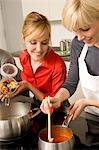 Two young women preparing food in the kitchen Stock Photo - Premium Royalty-Freenull, Code: 6108-05861127