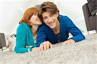 Portrait of a young woman whispering to a teenage boy Stock Photo - Premium Royalty-Freenull, Code: 6108-05861186