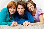 Portrait of a teenage boy smiling with two young women Stock Photo - Premium Royalty-Freenull, Code: 6108-05861224