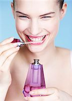smelly - Young woman smelling perfume Stock Photo - Premium Royalty-Freenull, Code: 6108-05861326