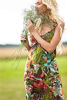 smelly - Young woman holding bunch of flowers Stock Photo - Premium Royalty-Freenull, Code: 6108-05861500