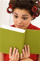 Close-up of a woman reading a book Stock Photo - Premium Royalty-Freenull, Code: 6108-05861811