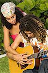 Man teaching a woman how to play a guitar Stock Photo - Premium Royalty-Free, Artist: ableimages, Code: 6108-05861970
