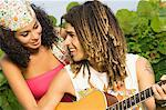 Couple playing a guitar and smiling at each other Stock Photo - Premium Royalty-Free, Artist: CulturaRM, Code: 6108-05861974