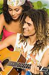 Couple playing a guitar Stock Photo - Premium Royalty-Free, Artist: AWL Images, Code: 6108-05861976