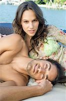 Portrait of a couple resting at a tourist resort Stock Photo - Premium Royalty-Freenull, Code: 6108-05862085