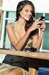 Woman text messaging and smiling Stock Photo - Premium Royalty-Free, Artist: AWL Images, Code: 6108-05862171