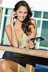 Woman talking on a mobile phone Stock Photo - Premium Royalty-Free, Artist: AWL Images, Code: 6108-05862196