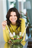 Portrait of a woman mixing salad Stock Photo - Premium Royalty-Freenull, Code: 6108-05862388