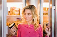 fridge - Close-up of a woman looking at a can Stock Photo - Premium Royalty-Freenull, Code: 6108-05862513