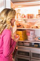 fridge - Close-up of a woman opening refrigerator in the kitchen Stock Photo - Premium Royalty-Freenull, Code: 6108-05862542