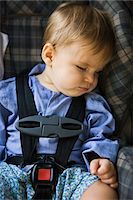 Baby boy sleeping in a baby seat Stock Photo - Premium Royalty-Freenull, Code: 6108-05862570