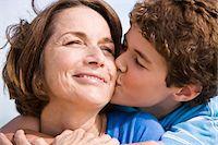 people kissing little boys - Boy kissing his grandmother Stock Photo - Premium Royalty-Freenull, Code: 6108-05862612