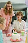 Girl celebrating her birthday with her family Stock Photo - Premium Royalty-Free, Artist: CulturaRM, Code: 6108-05862682