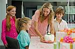 Woman celebrating her daughter's birthday Stock Photo - Premium Royalty-Free, Artist: Photocuisine, Code: 6108-05862699