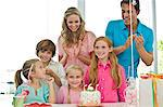 Girl celebrating her birthday with her parents and friends Stock Photo - Premium Royalty-Free, Artist: CulturaRM, Code: 6108-05862702