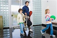 Man entering the house with his children Stock Photo - Premium Royalty-Freenull, Code: 6108-05862773