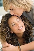 Teenage boy kissing on the forehead of a girl Stock Photo - Premium Royalty-Freenull, Code: 6108-05862890